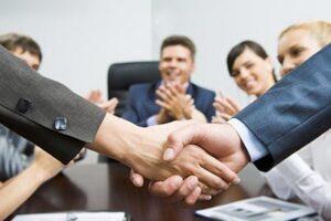 Alarm Company Sale Closing Handshake