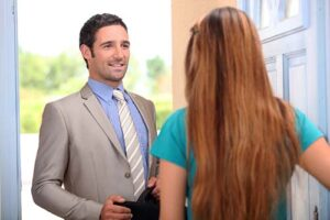 Door to door security alarm salesman making a sale