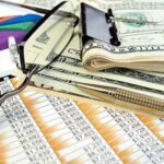 Alarm company owner's finance calculations when selling business with a central station