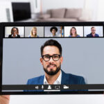 Man Working From Home Online Group Videoconference On Tablet