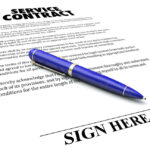 Service Contract agreement document with blue pen to sign name on the signature line
